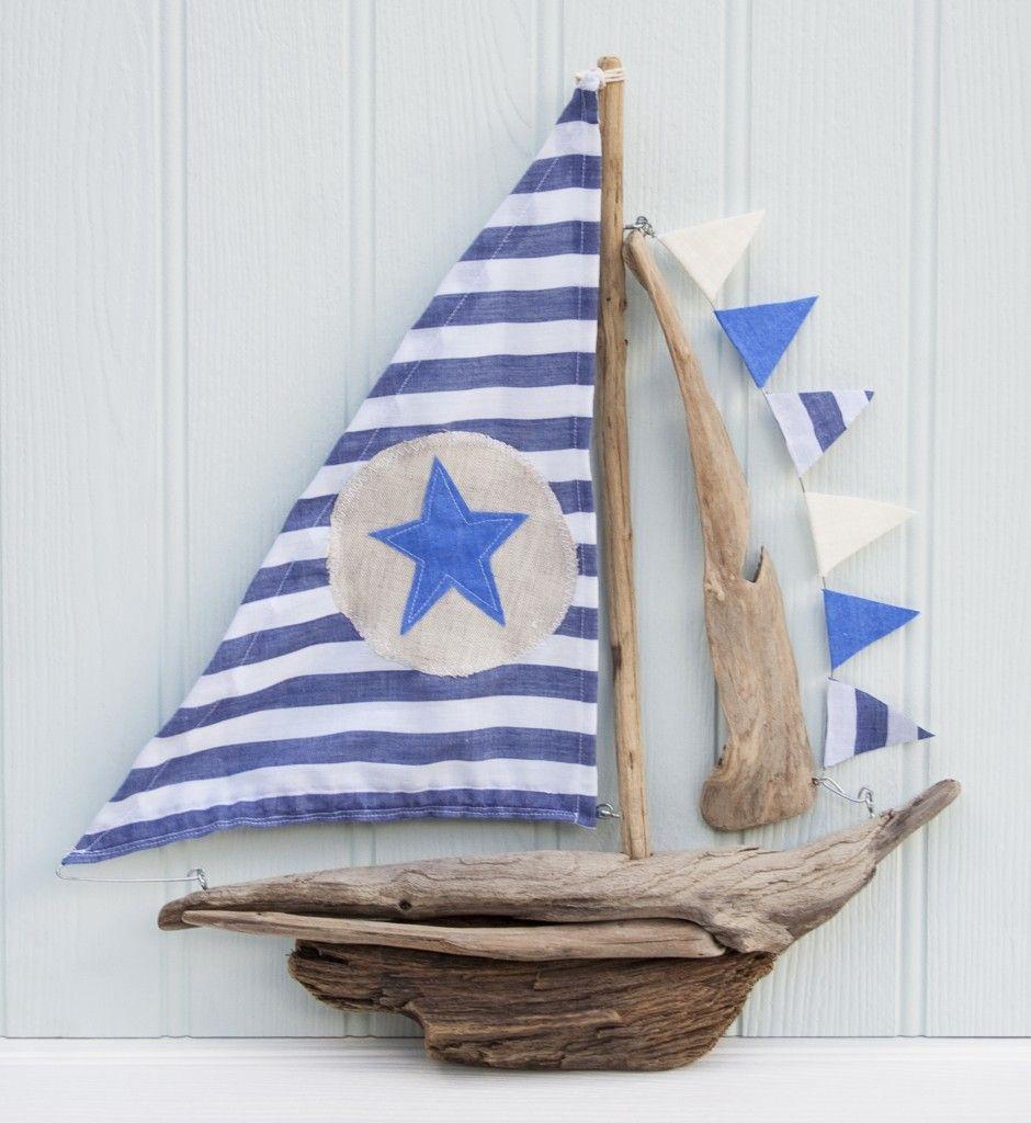bateau-bois-dérive-bleu