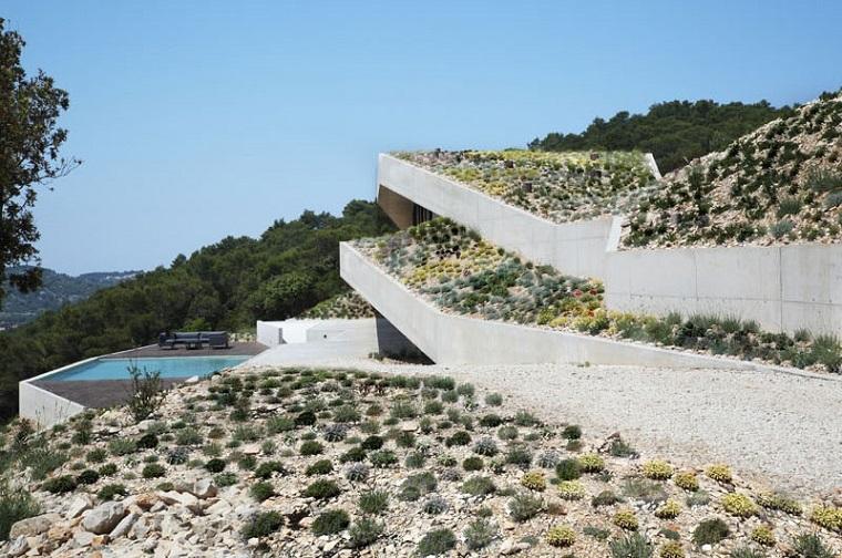 paysage naturel maison intégré des roches